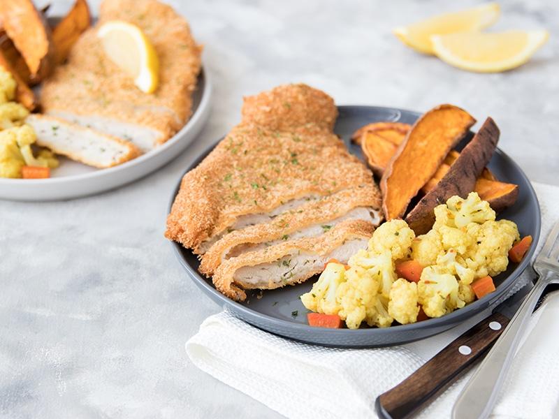 Recept voor zelfgemaakte schnitzel met bloemkool, paprika en aardappels